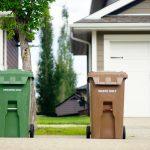 green and brown trash bins